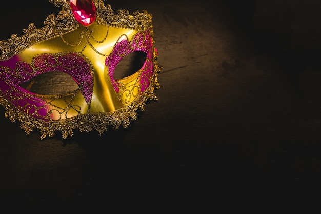 Golden venetian mask on a dark background Free Photo