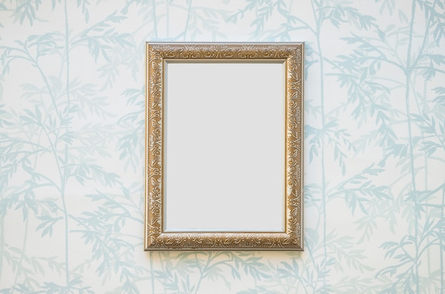 Golden white picture frame on wallpaper Free Photo