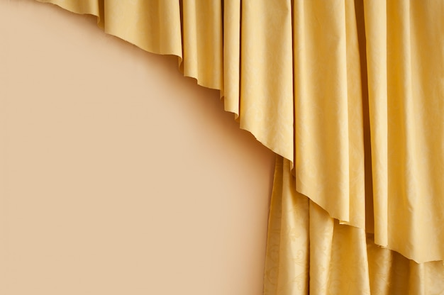 Golden yellow silk curtain background in the room Premium Photo