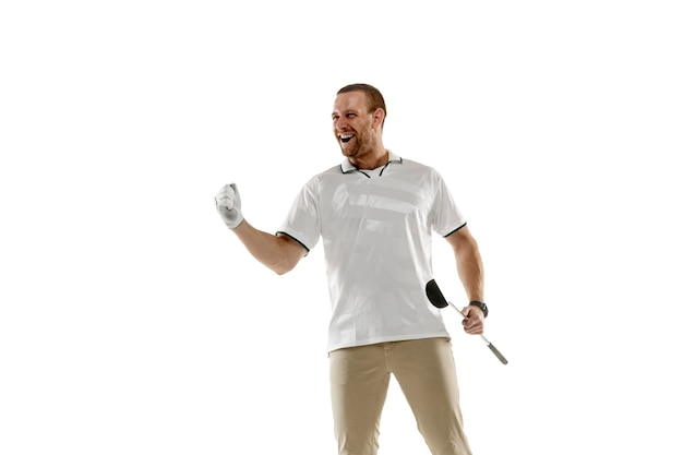 Golf player in a white shirt taking a swing isolated on white  wall with copyspace. professional player practicing with bright emotions and facial expression. sport concept. Free Photo