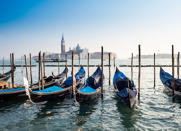Gondolas with san giorgio di maggiore church in venice, italy Premium Photo