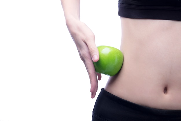 Good healthy body and curve waist and green apple Free Photo