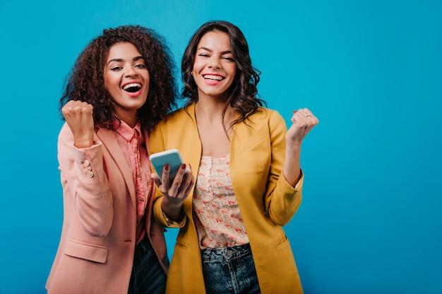 Good-humoured women having fun together Free Photo