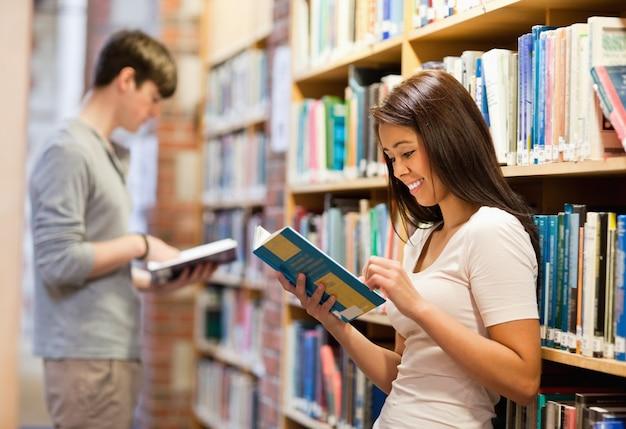 Good looking students reading books Premium Photo