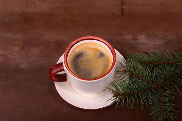 Good morning or have a nice day merry christmas .cup of coffee with cookies and fresh fir or pine branch Premium Photo