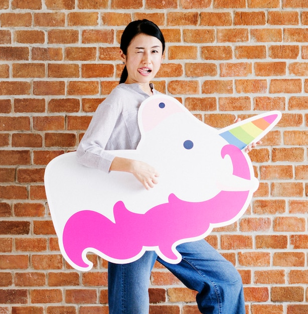 Goofy faced woman with a unicorn Premium Photo