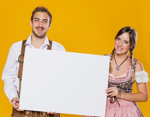 Gorgeous bavarian couple together Free Photo