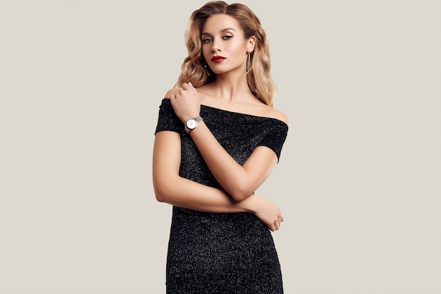 Gorgeous elegant sensual blonde woman wearing fashion black dress Premium Photo