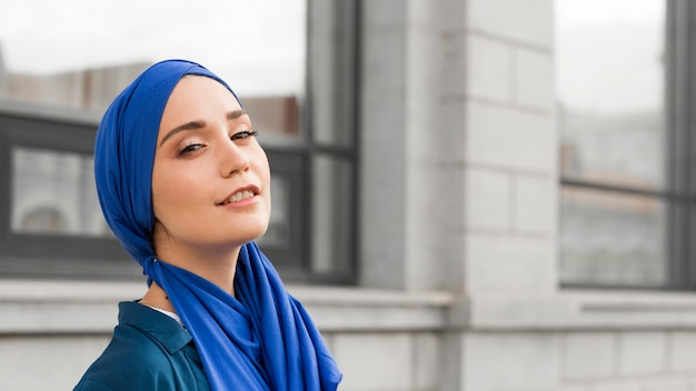 Gorgeous girl with hijab smiling with copy space Free Photo
