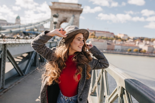 Gorgeous young woman posing with excitement during travel in europe Free Photo