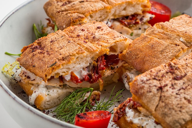 Gourmet festive sandwiches with sundried tomatoes Premium Photo