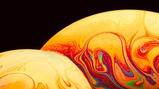 Gradient artistic saturated soap bubbles on black background Free Photo