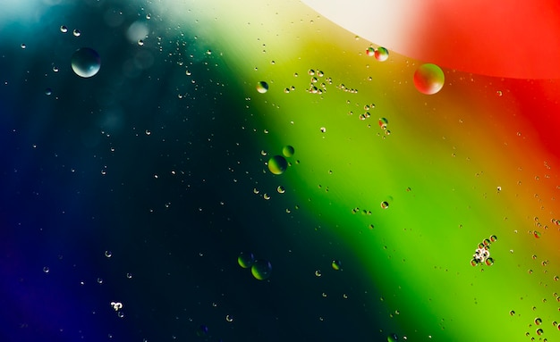 Gradient colourful background with droplets Free Photo