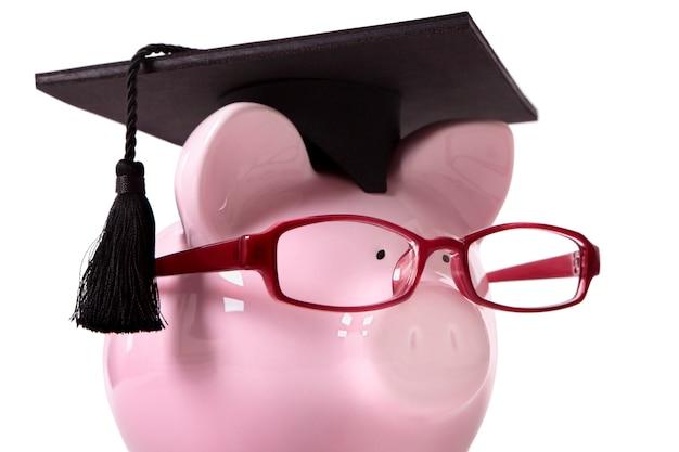 Graduate piggy bank Premium Photo