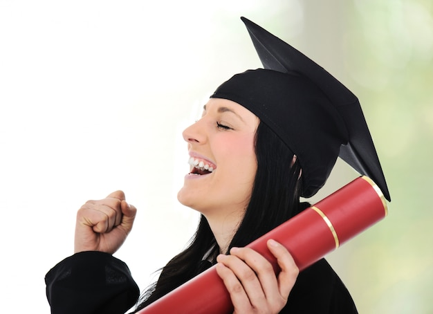 Graduating glory and pride, happy female with diploma in hands Premium Photo