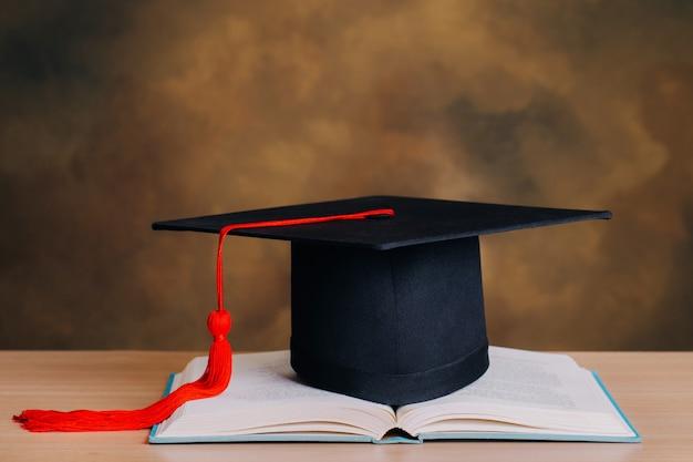 Graduation cap over open books. education concept. graduation day Premium Photo