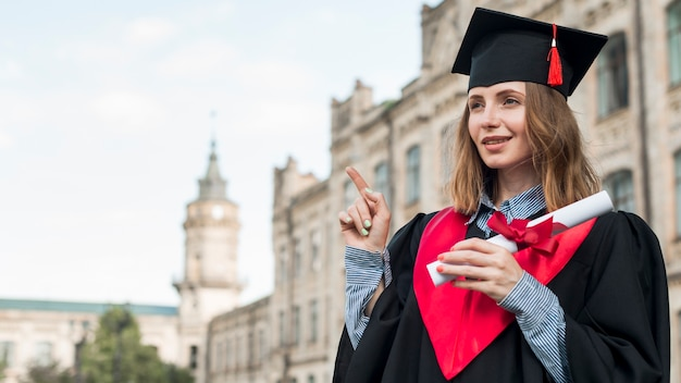 Graduation concept with portrait of happy girl Free Photo