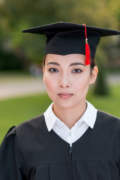Graduation concept with portrait of happy woman Free Photo