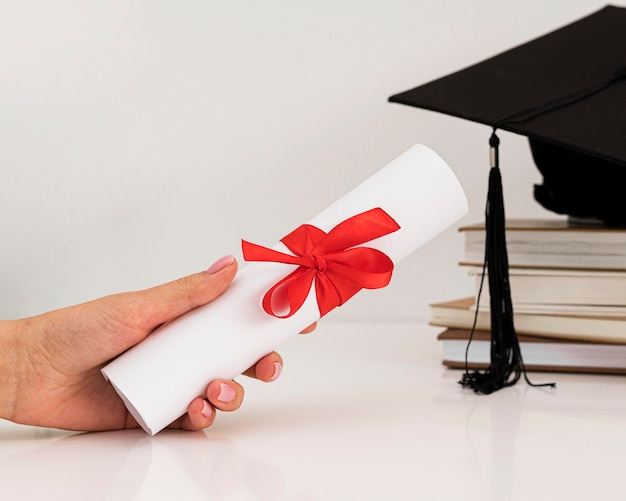 Graduation diploma certificate with ribbon and bow Premium Photo
