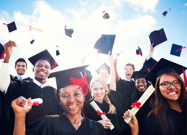 Graduation group of people celebration learning diversity throw Premium Photo
