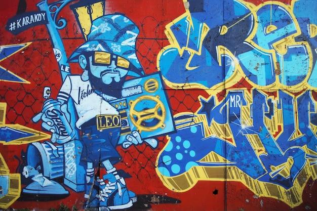 Graffiti of a graffiti on a brick wall Free Photo