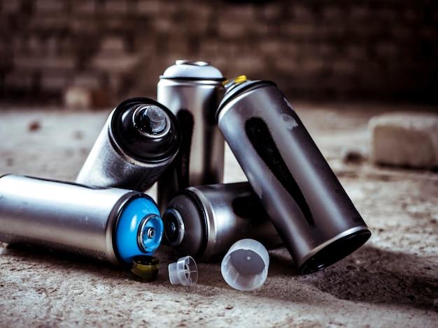 Graffiti spray paint aerosol cans close up shot Premium Photo