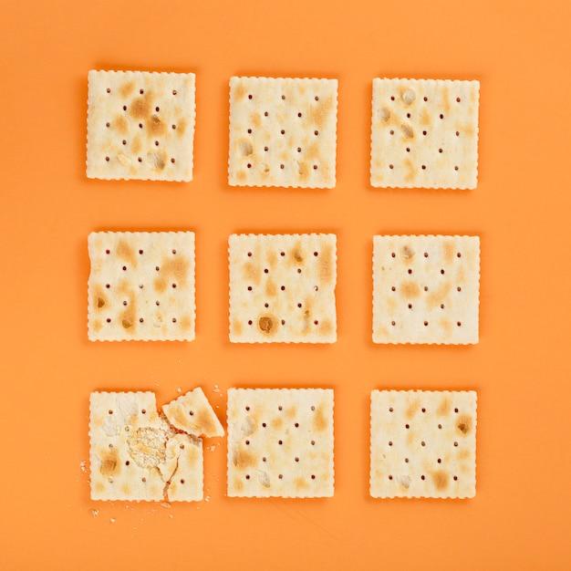 Graham crackers on orange background Free Photo
