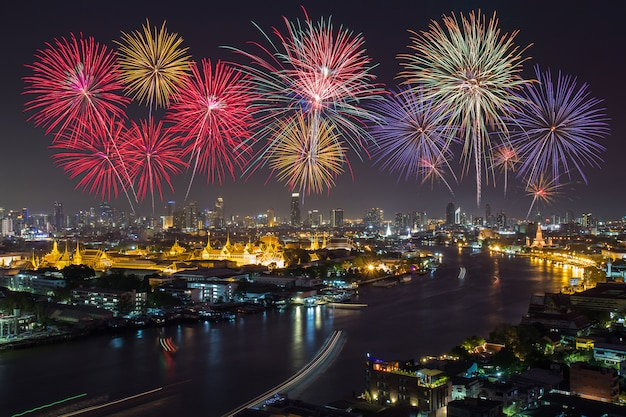Grand palace and bangkok city with colorful fireworks, thailand Premium Photo