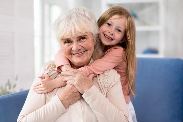 Grandma and girl hugging Premium Photo