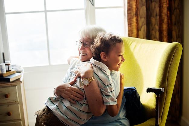 Grandma and grandson hugging together Free Photo