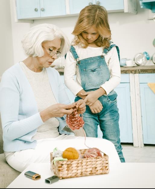 Grandma and her grandchild knitting fun together Premium Photo