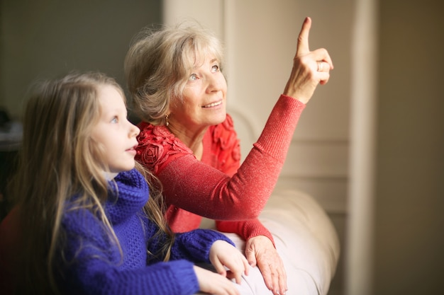 Grandma teaching her granddaughter Premium Photo