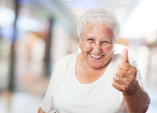 Grandma with thumb up Free Photo