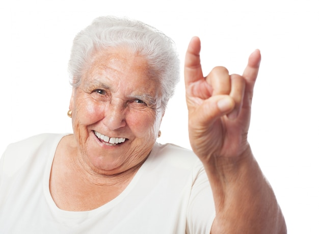 Grandmother doing the horns Free Photo