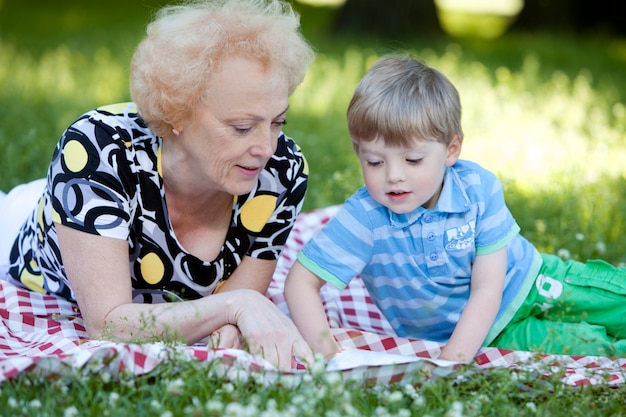 Grandmother with her grandson in the park Free Photo