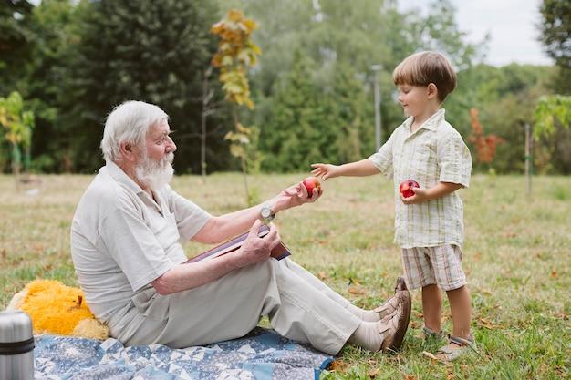 Grandpa and grandson at picnic in nature Free Photo