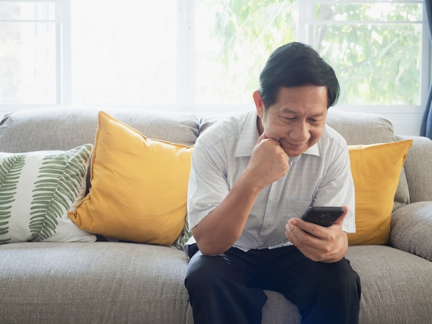 Grandpa is stressed with mobile work Premium Photo
