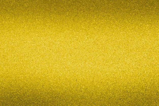 Granite background of golden color with small dots. darkening from the top and bottom. Premium Photo