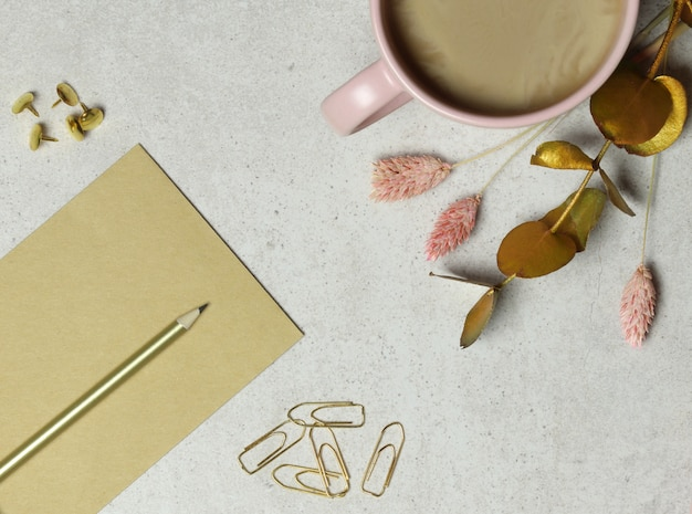 Granite background with craft notes, golden pencil, paper clips, cup of coffee Premium Photo