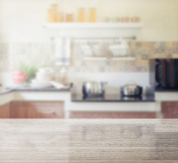Granite table top and blur of modern kitchen interior as background Premium Photo