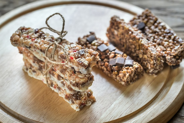 Granola bars with dried berries and chocolate Premium Photo