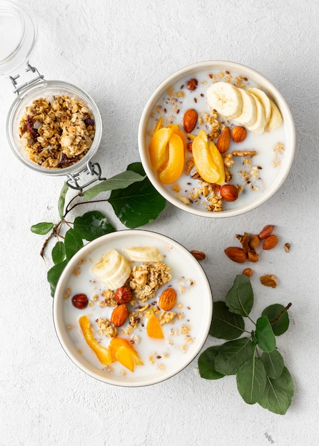 Granola cereal with fruits, nuts, milk and peanut butter Premium Photo