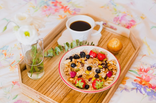 Granola and coffee for breakfast in bed Free Photo