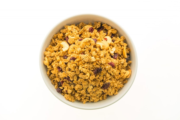 Granola in white bowl Free Photo