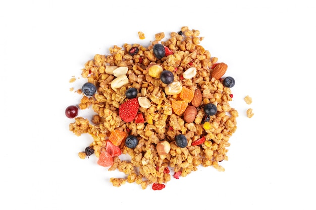 Granola with dried fruits isolated on white Premium Photo