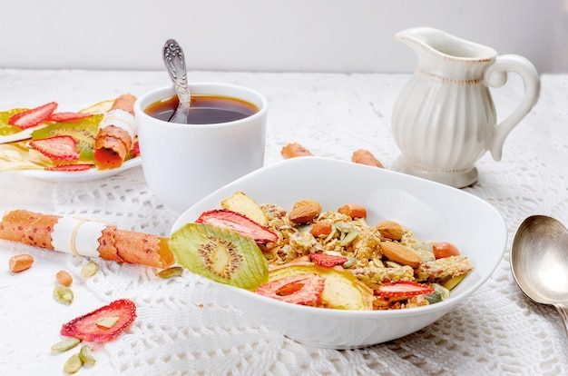 Granola  with fruit, chips and coffee Premium Photo