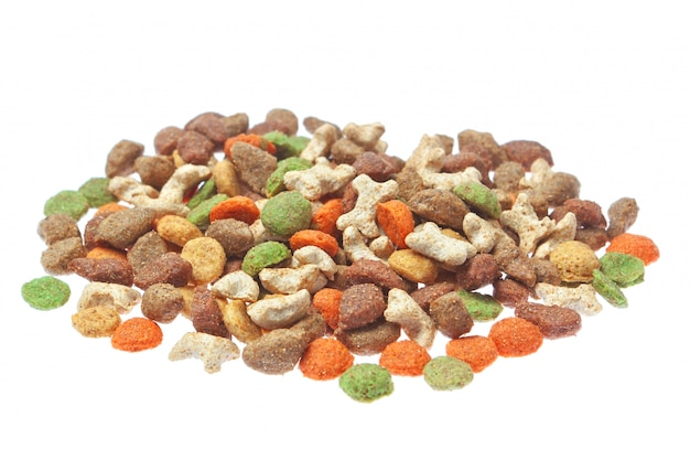 Granulated feed for cats and dogs. on a white wall. Premium Photo