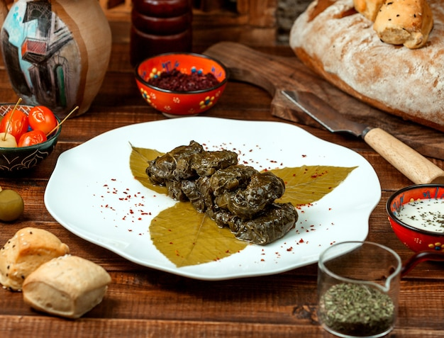 Grape leaf dolma with spices Free Photo