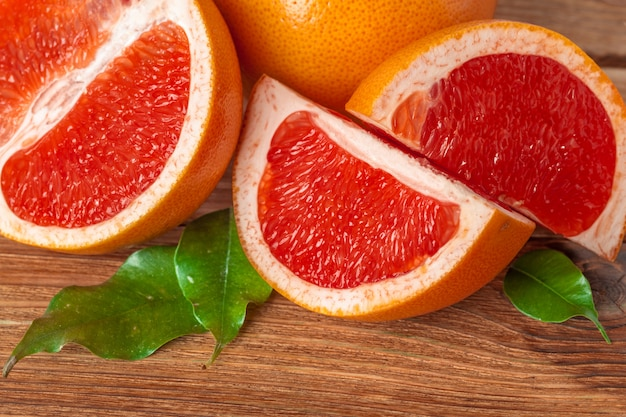 Grapefruit with slices on a wooden table. Premium Photo