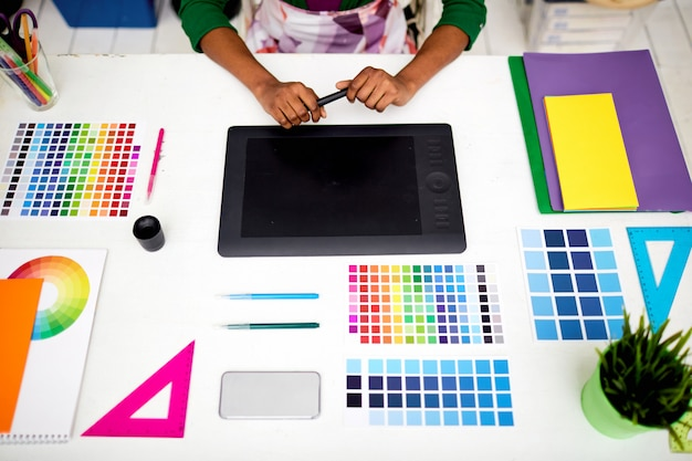 Graphic designer at office with tools Free Photo